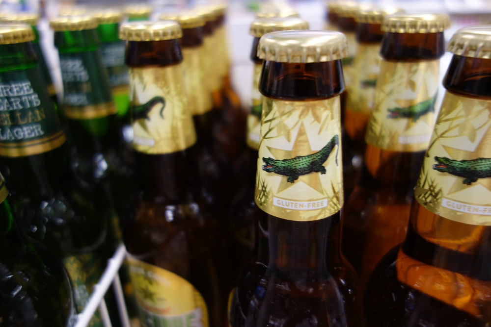 brown glass bottles on white steel rack