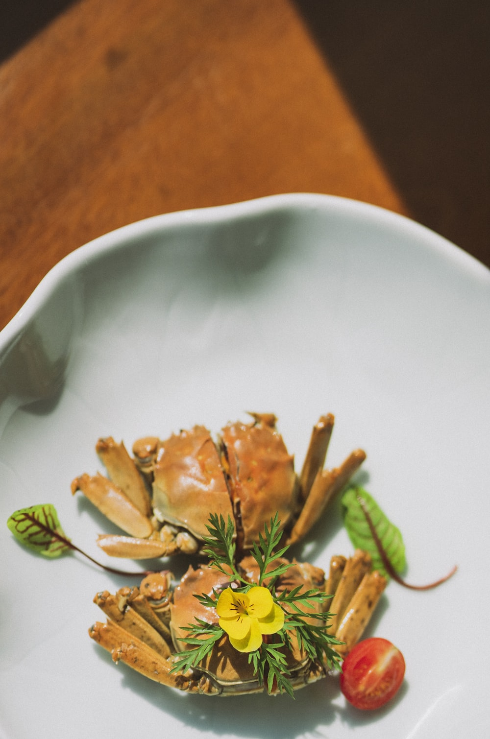 cooked crab on white ceramic plate