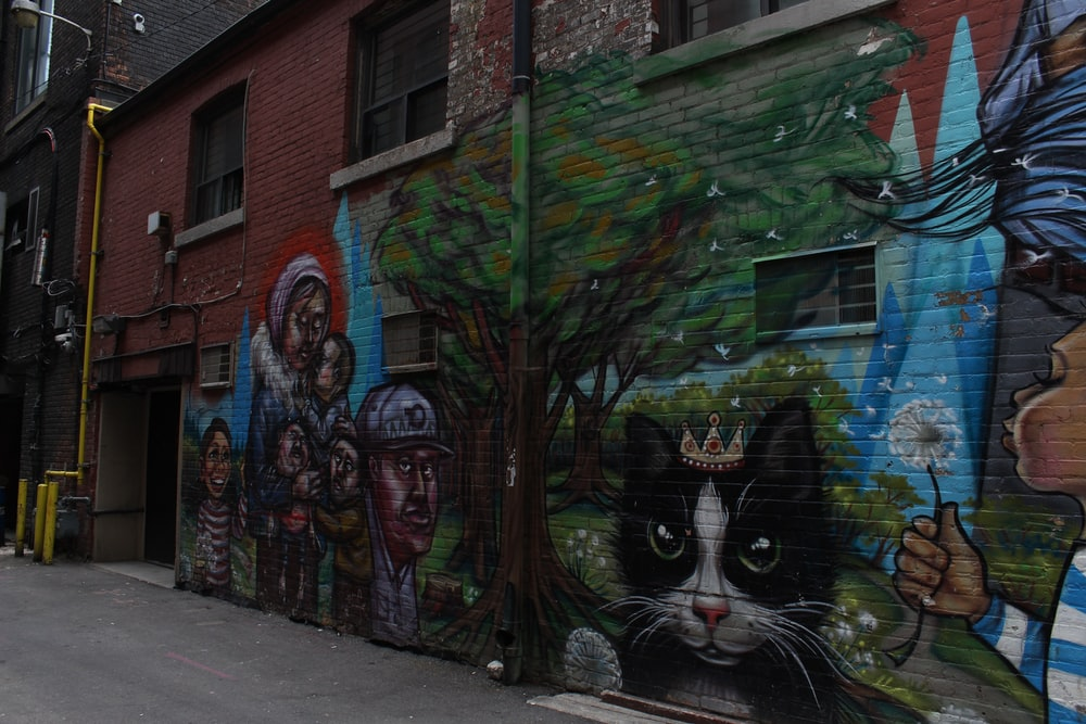 graffiti on brown brick building