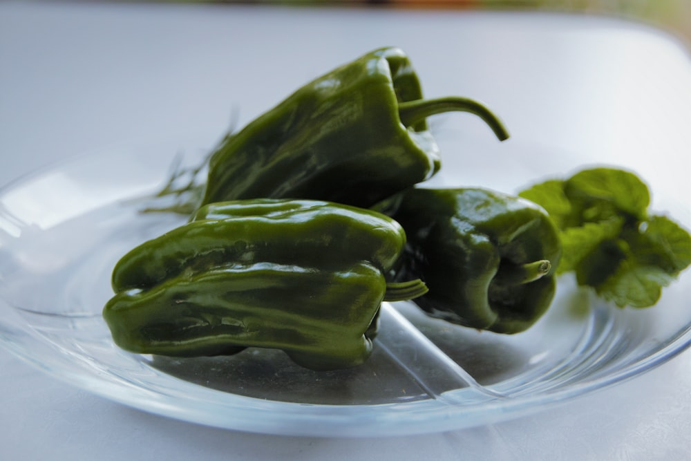 green bell pepper on clear glass bowl