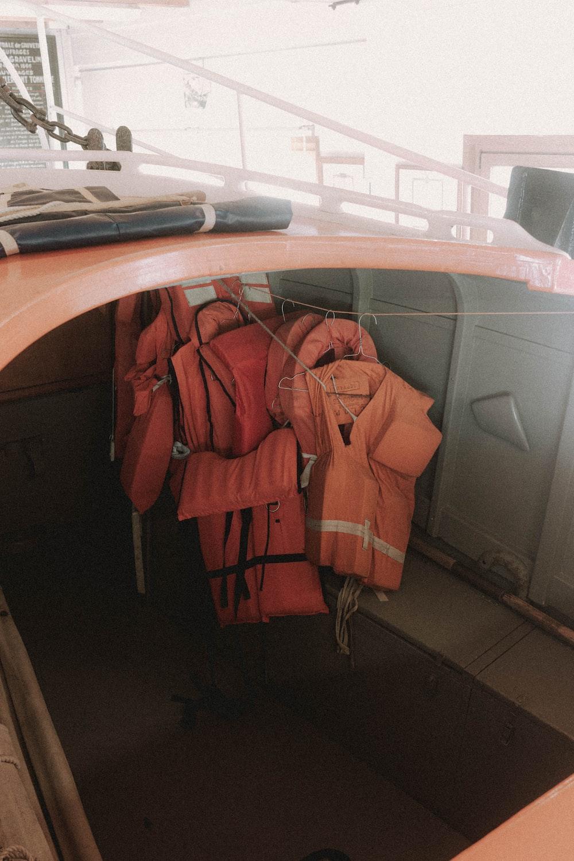 orange jacket on brown wooden desk