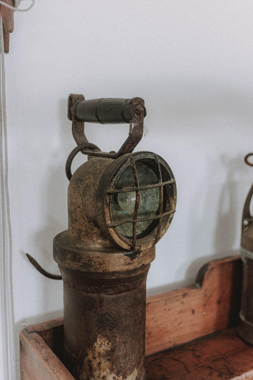 black metal bell on brown wooden table
