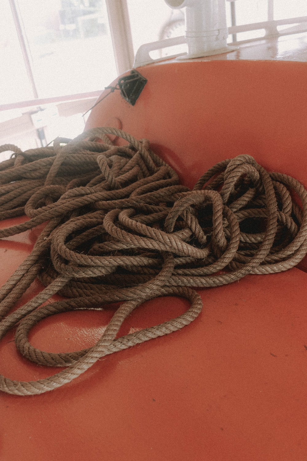 brown rope on red table