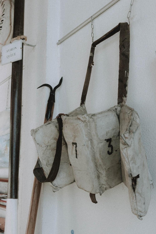 white and black sling bag