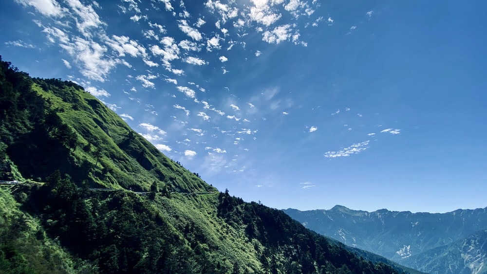 green mountains under blue sky during daytime