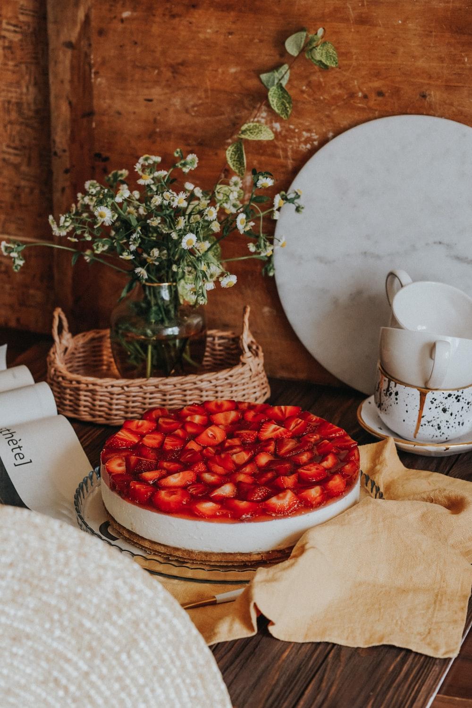 red round fruits on white ceramic bowl