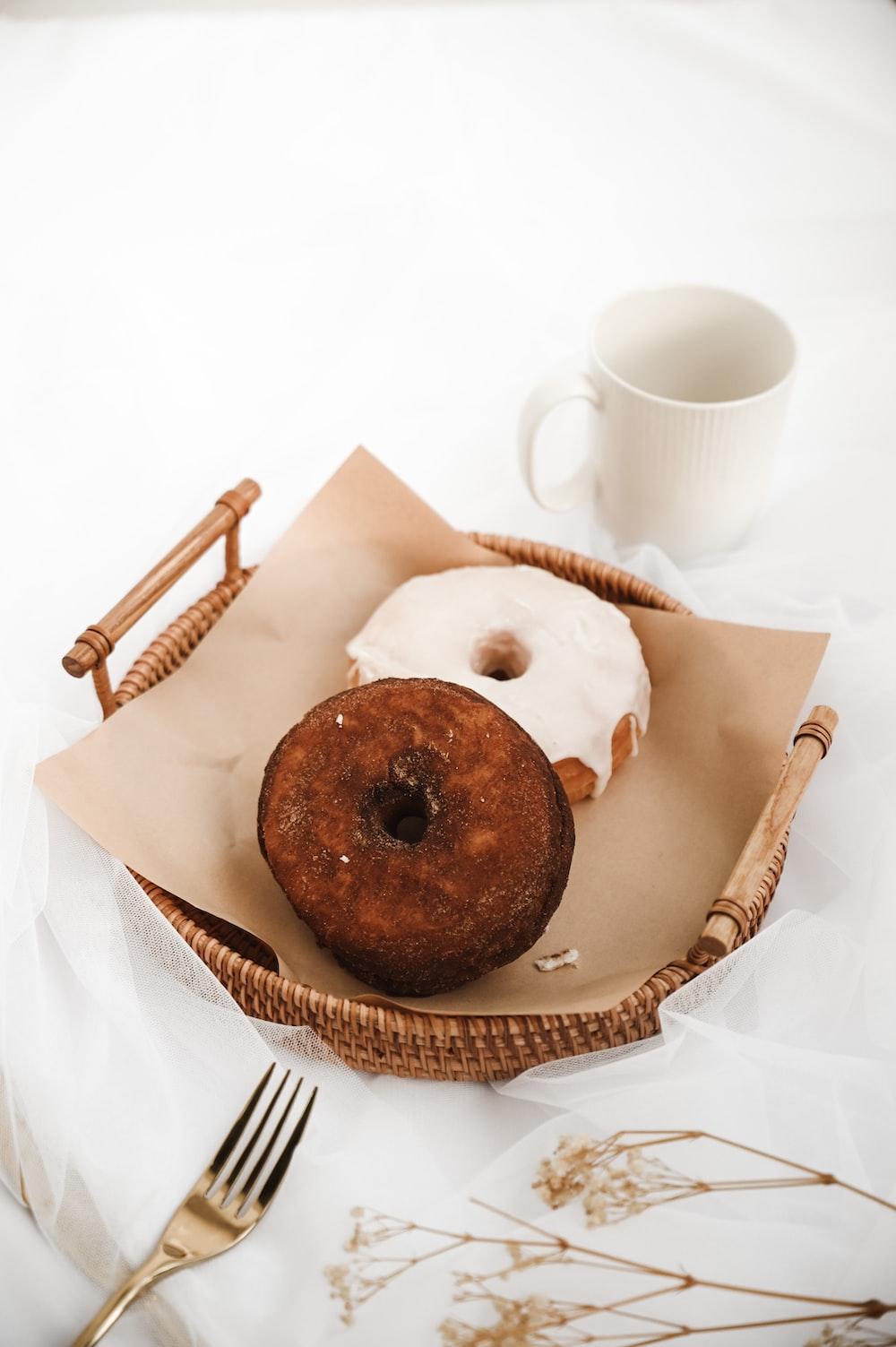 chocolate chip cookies on brown paper bag beside white ceramic mug