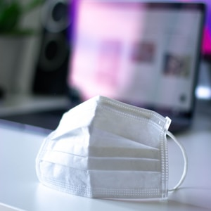 white leather pouch on white table
