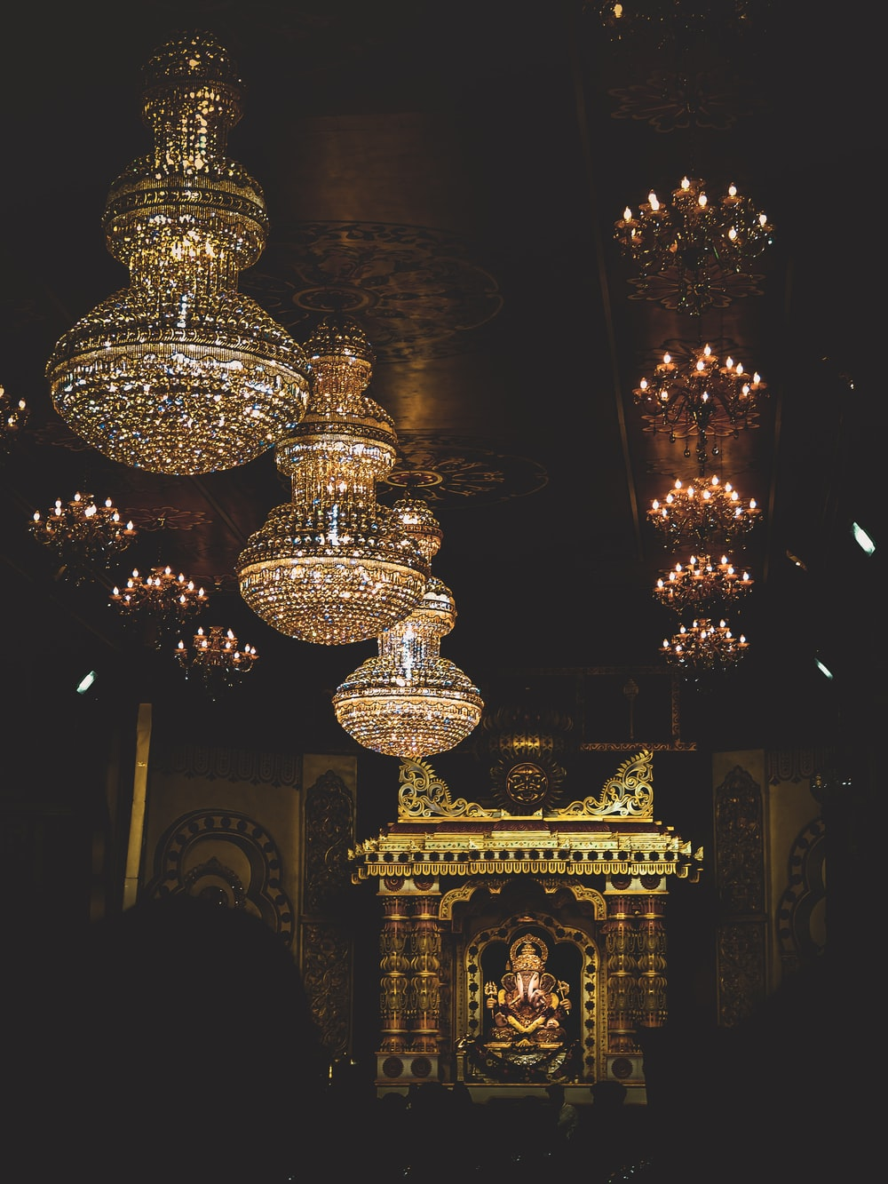 brass and crystal chandelier turned on during nighttime