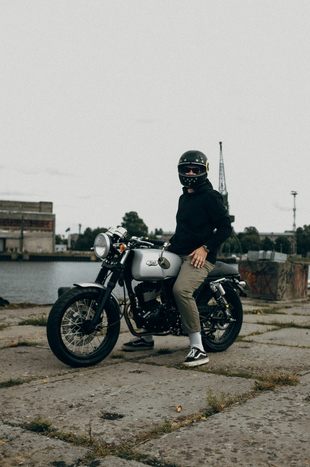 man in black helmet riding on white and black motorcycle