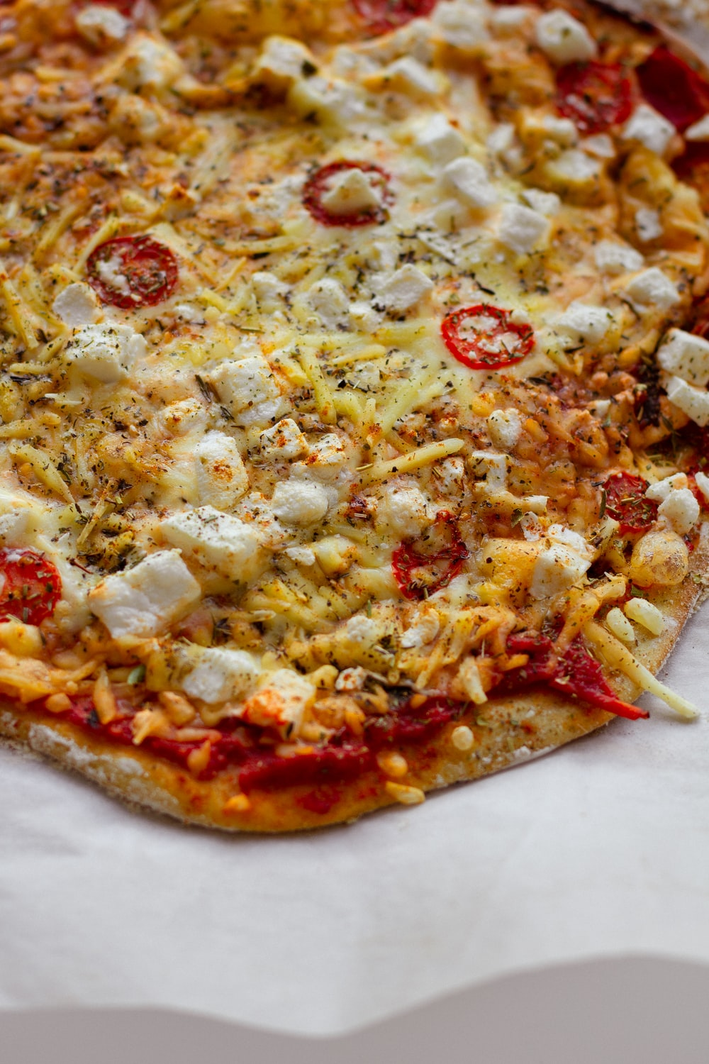pizza with cheese and green leaves
