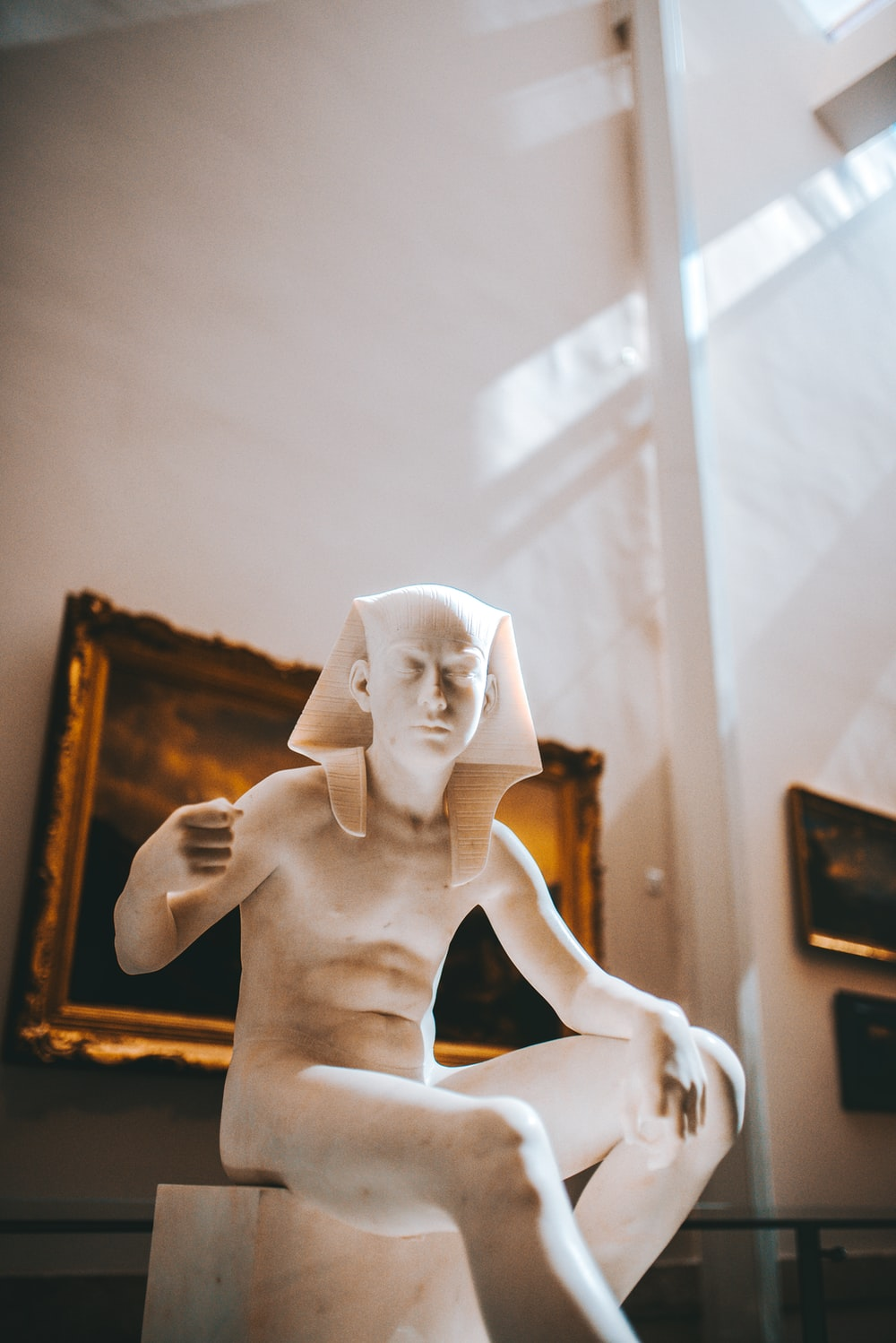 white ceramic figurine on brown wooden table