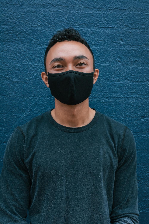 man in blue crew neck shirt wearing black mask