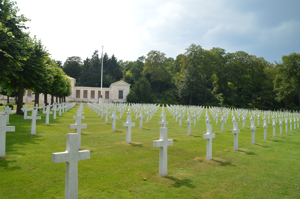 white cross on green grass field during daytime