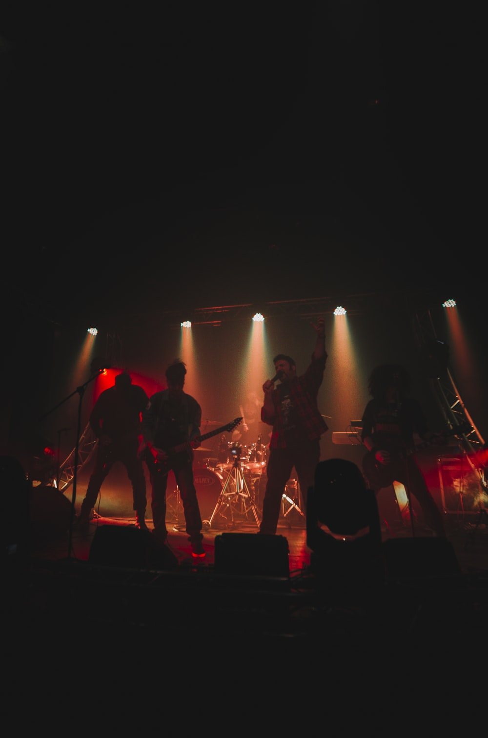 group of people playing musical instruments on stage