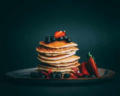 pancakes with strawberries and blueberries on top pancake zoom background