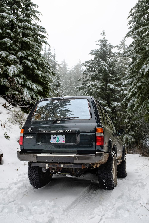 black suv on snow covered ground