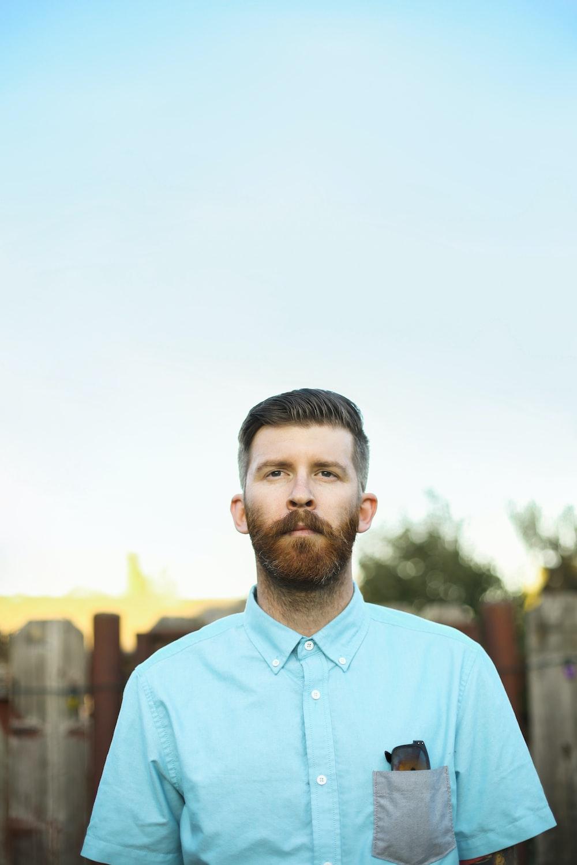 man in blue crew neck shirt