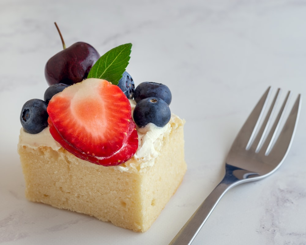 sliced cake with strawberry on top