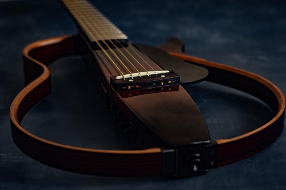 brown and black acoustic guitar