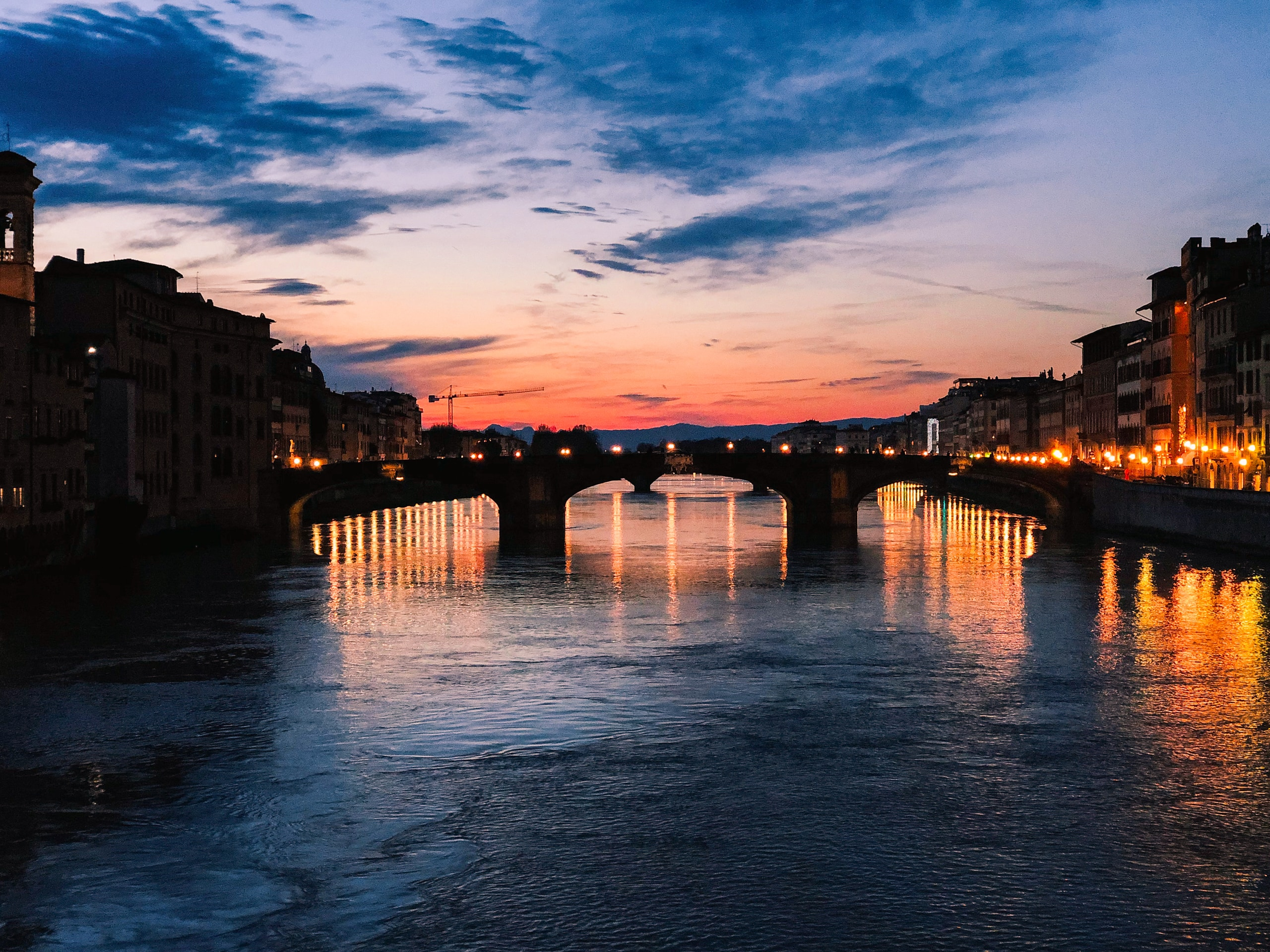 Florencia, body of water between buildings during sunset