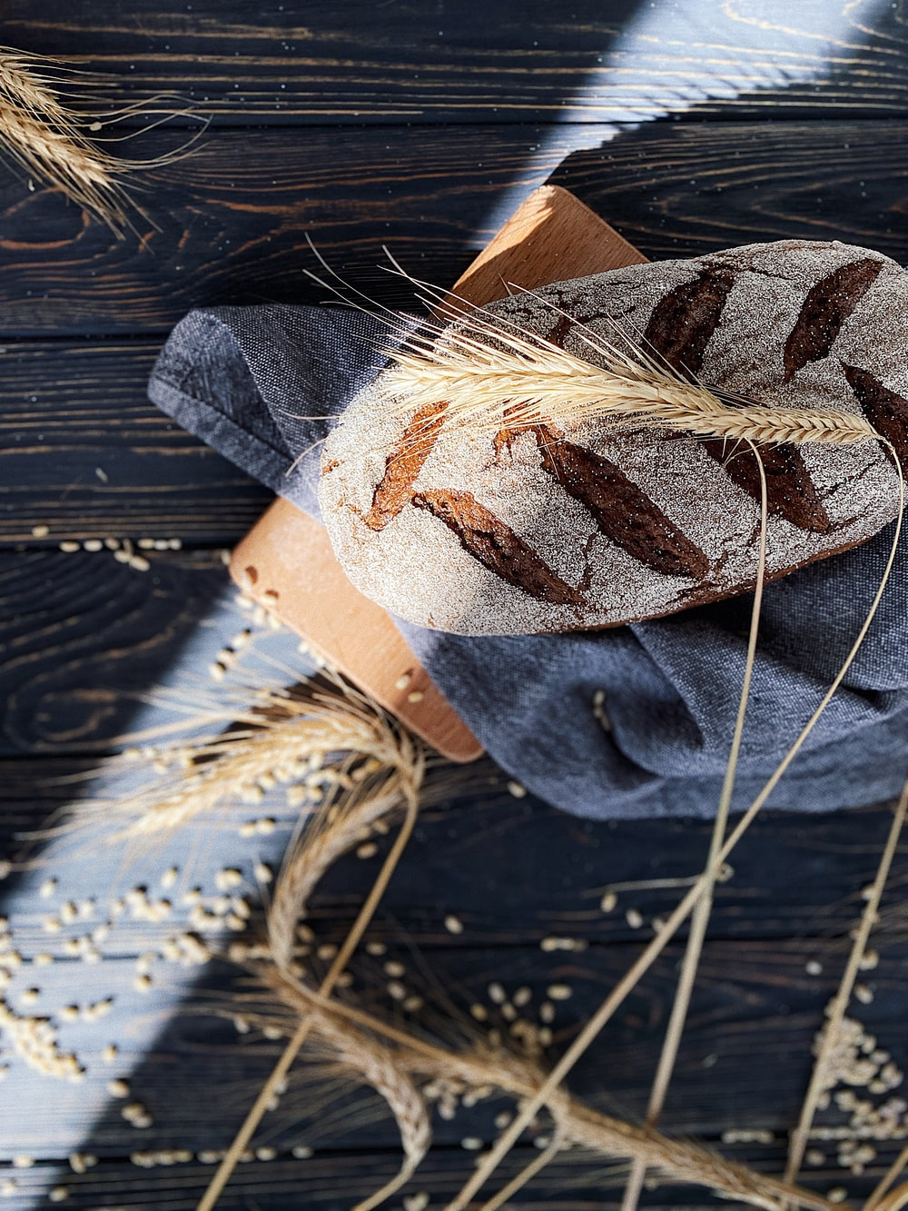 brown and white leaf on blue denim jeans