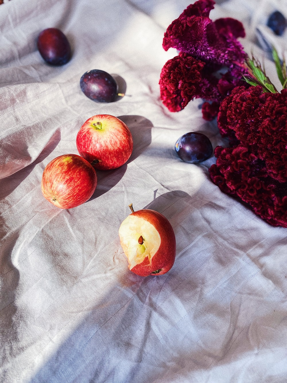 red fruits on white textile