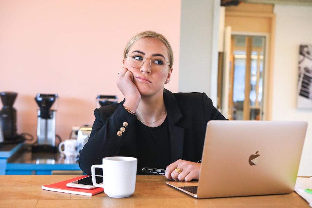 woman in black long sleeve shirt using macbook