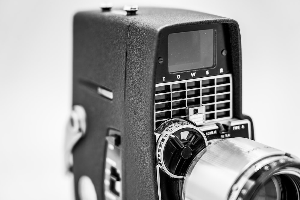 black and silver camera in grayscale photography