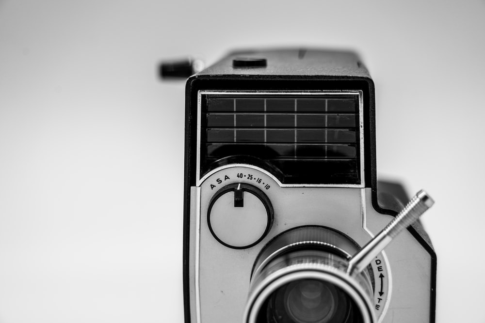 silver and black point and shoot camera