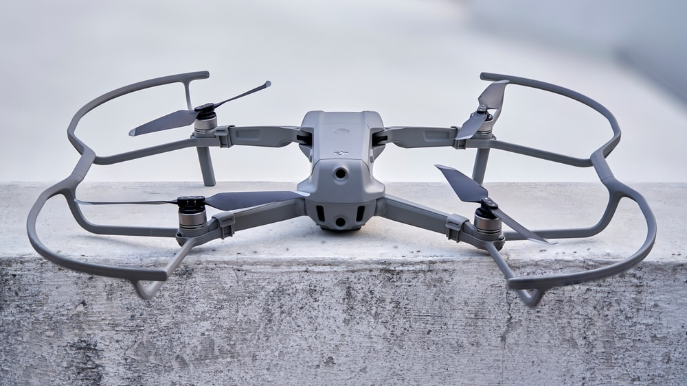gray and black drone on gray concrete floor