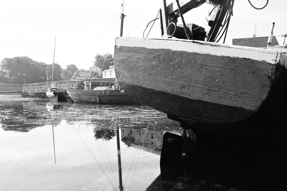 grayscale photo of boat on water
