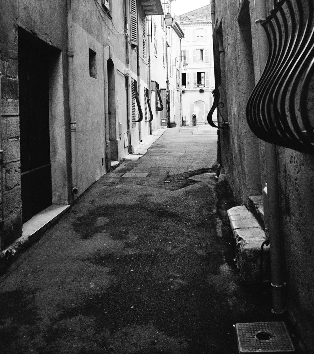 grayscale photo of alley with no people