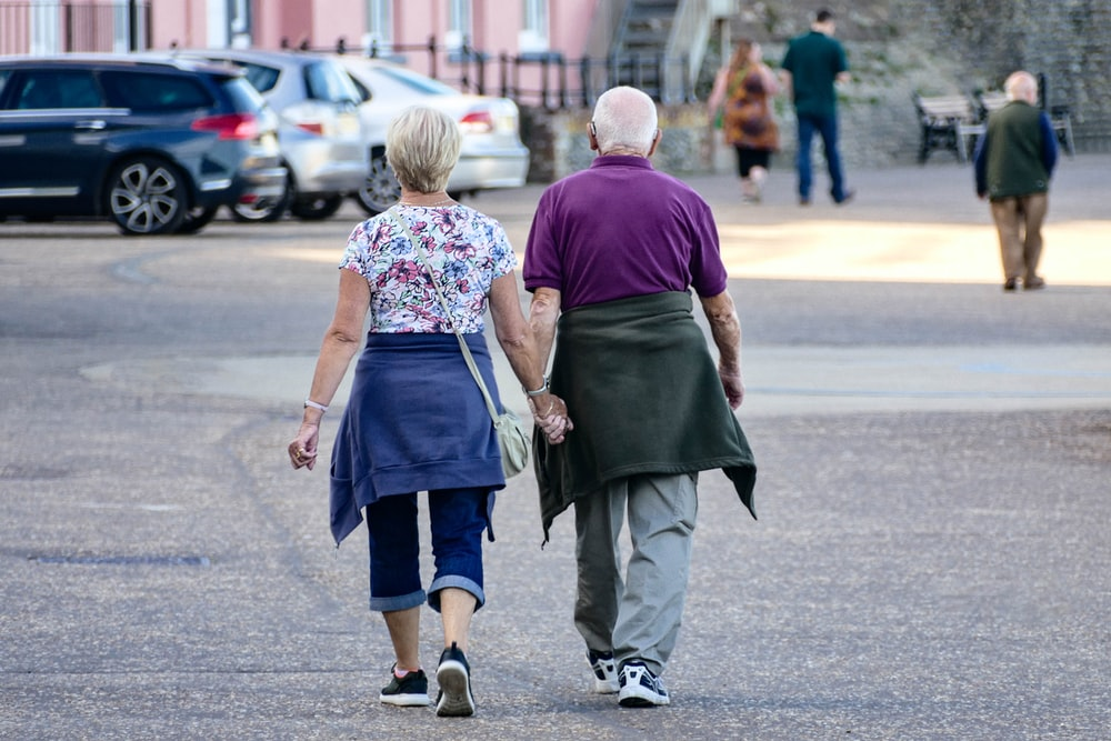 man and woman walking on the street during daytime