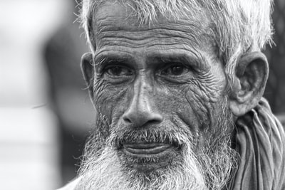 grayscale photo of mans face bangladesh zoom background