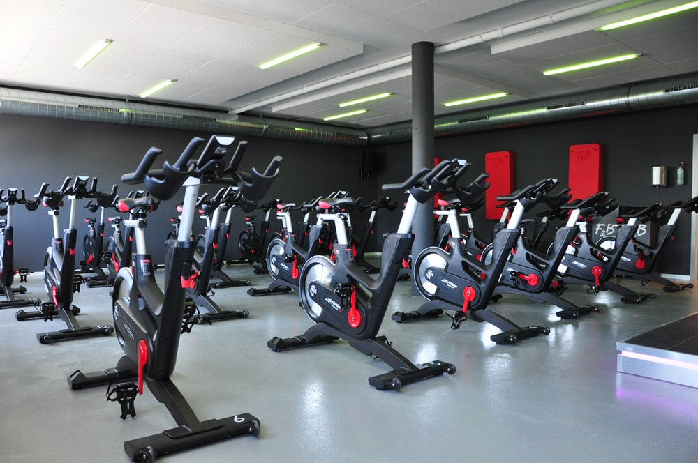 black and red stationary bikes