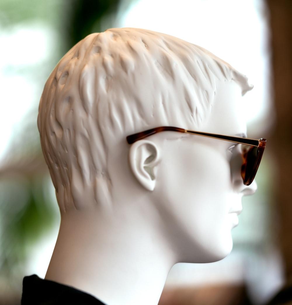 boy in black shirt wearing eyeglasses