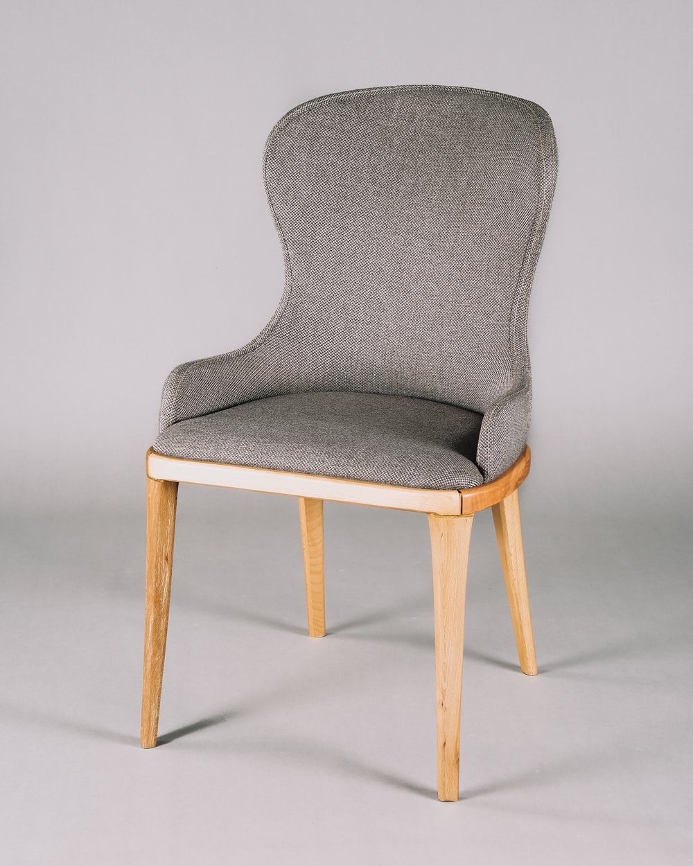 gray and white padded chair