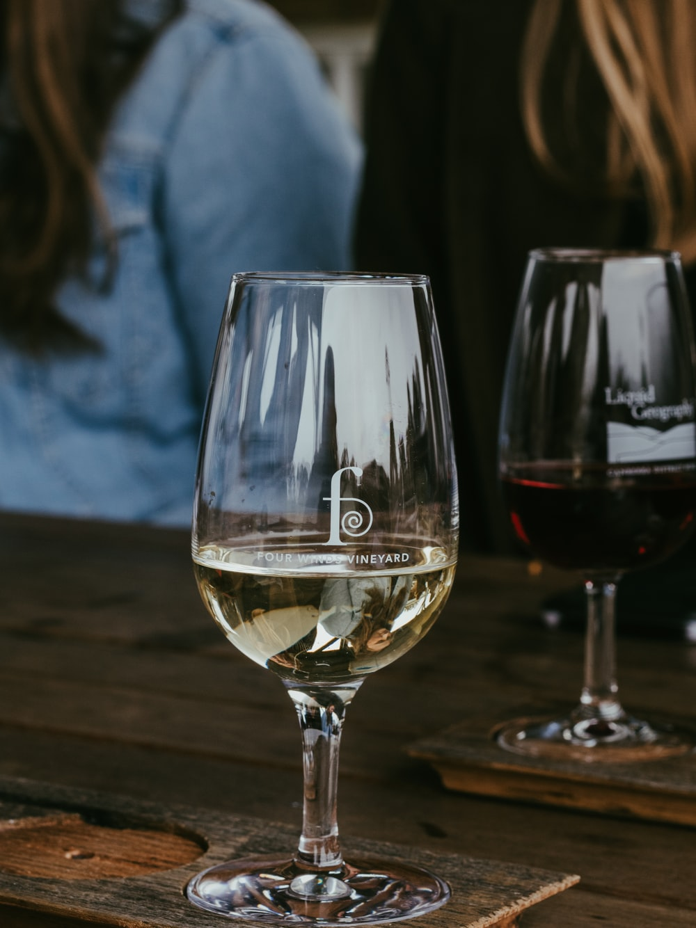 clear wine glass on brown wooden table