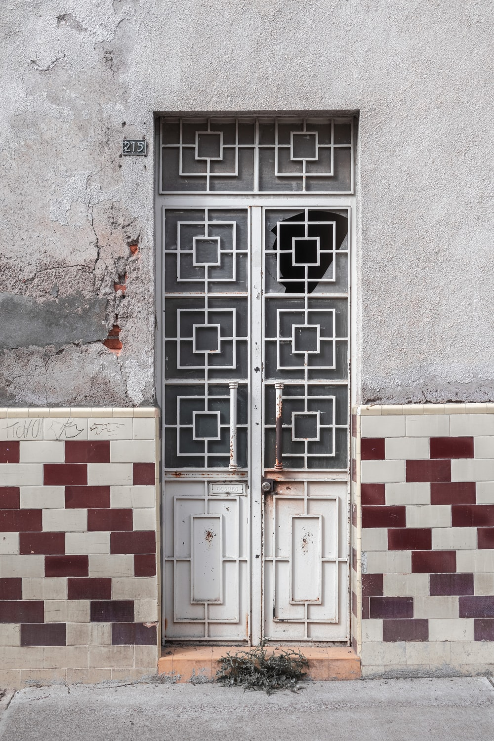 white and red wooden door