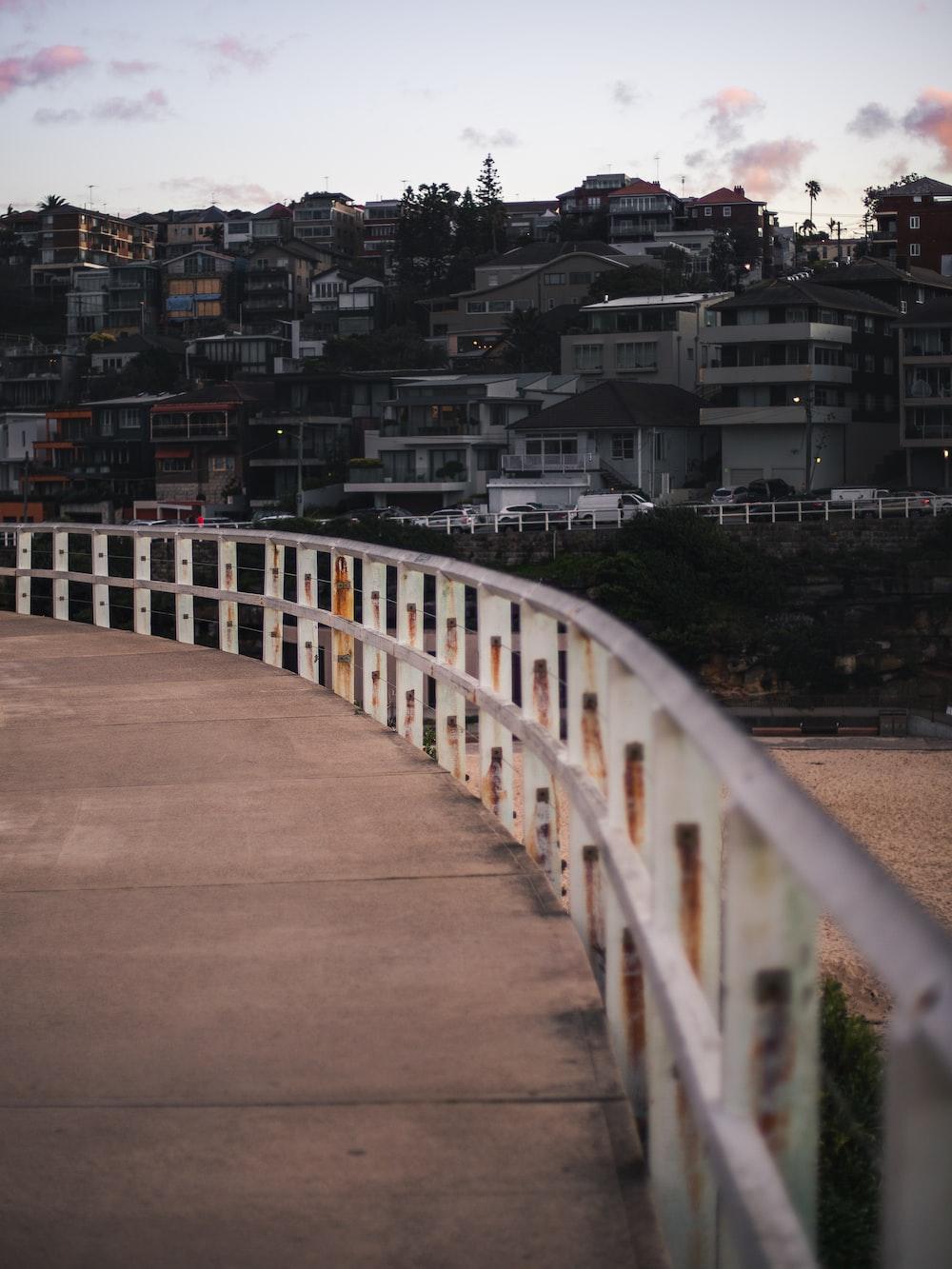 white wooden bridge over city during daytime