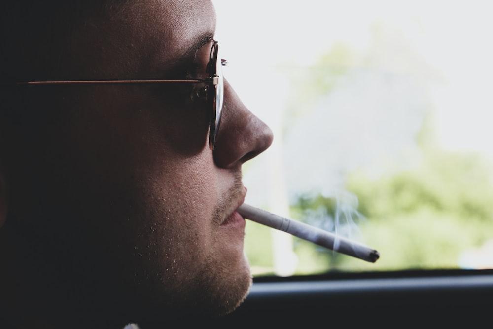 man smoking cigarette during daytime