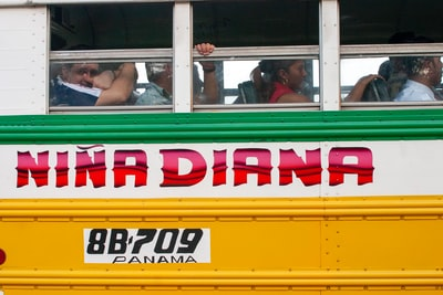 people in yellow and red bus during daytime panama zoom background
