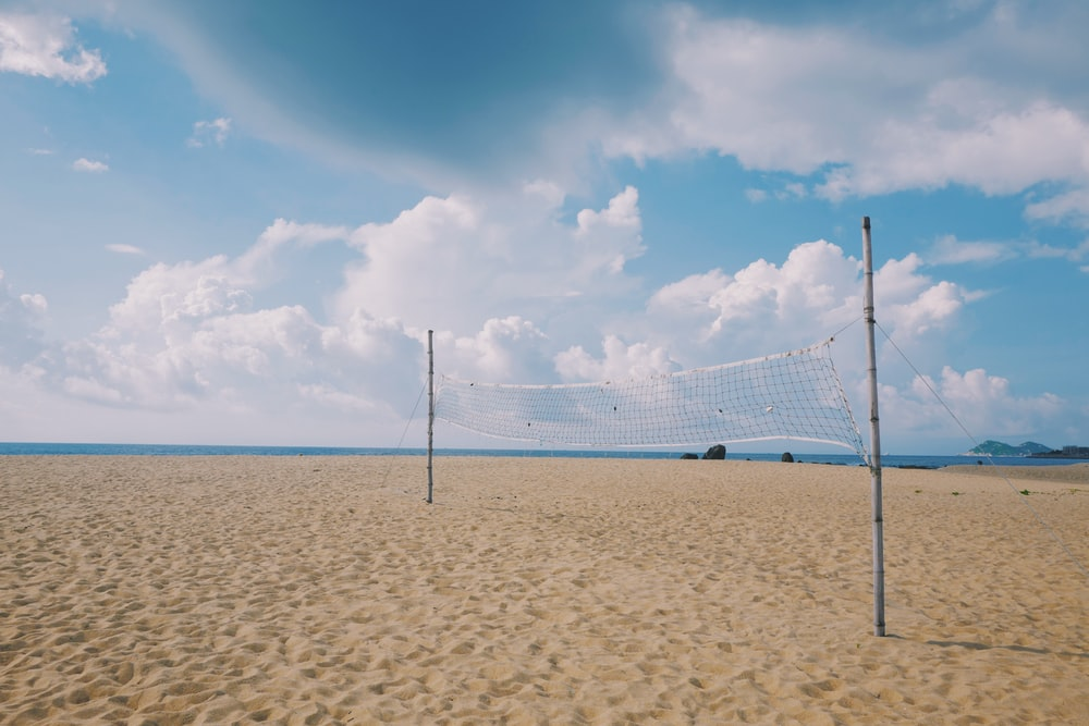white and blue net on beach during daytime