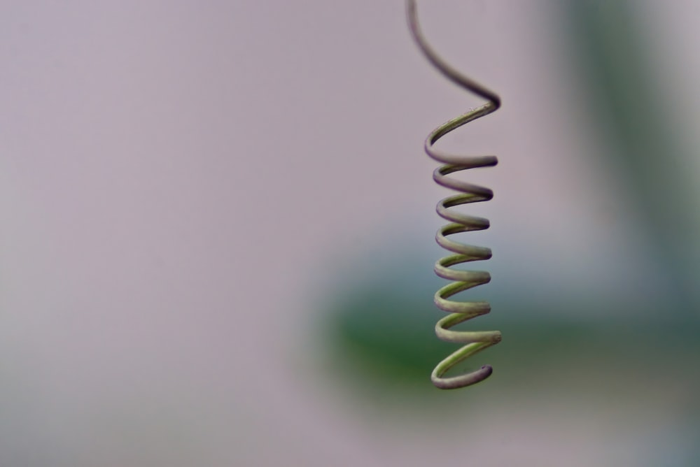 green spiral wire on white surface