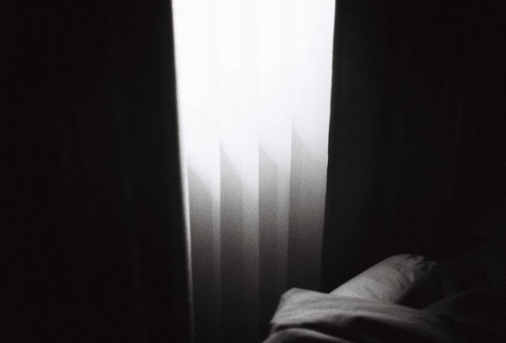 white window curtain near white textile