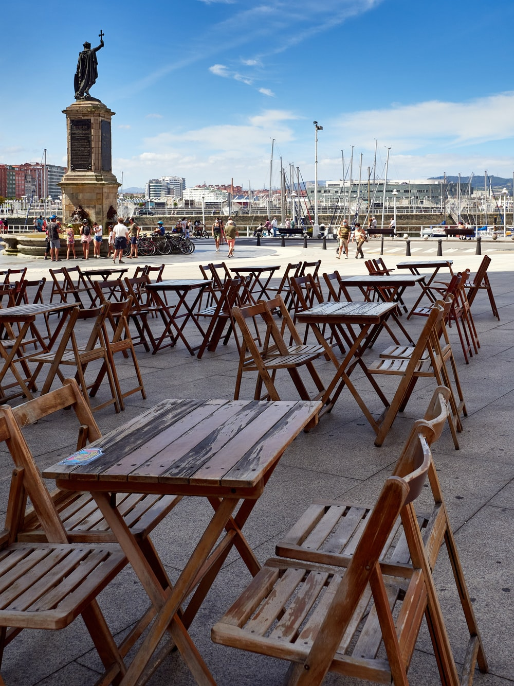 brown wooden folding chairs on gray concrete floor during daytime