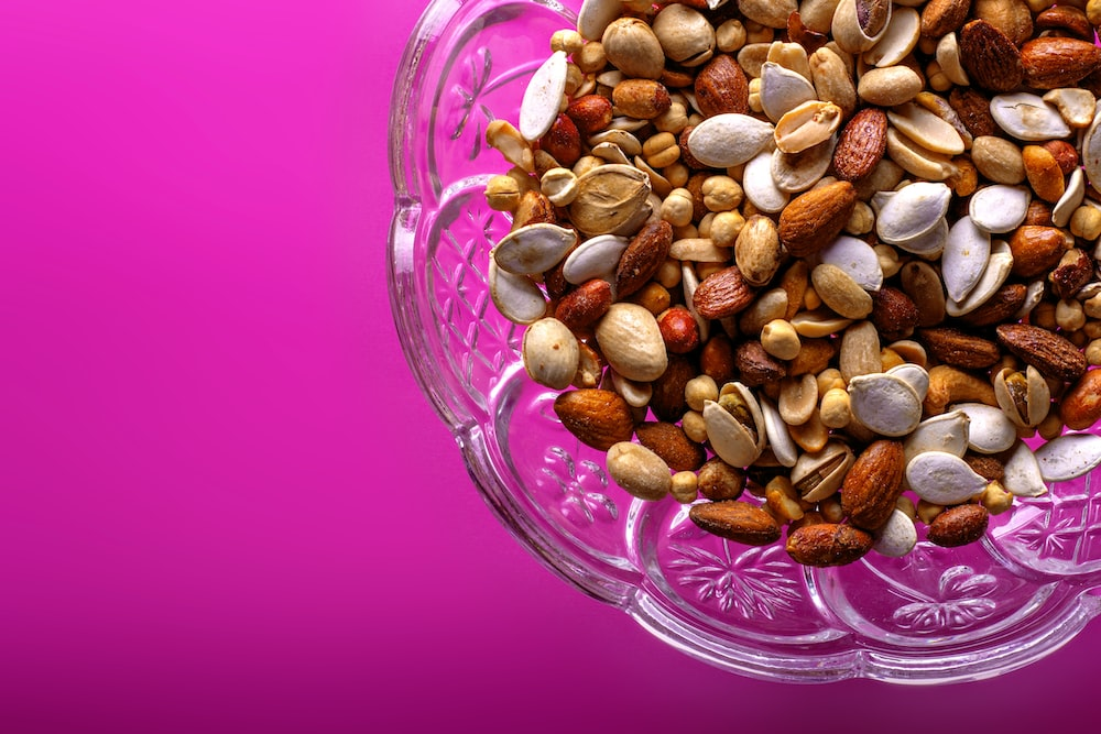 brown almond nuts on clear glass bowl