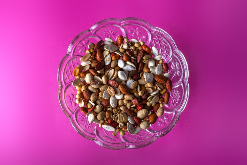 brown and white beans in clear glass bowl