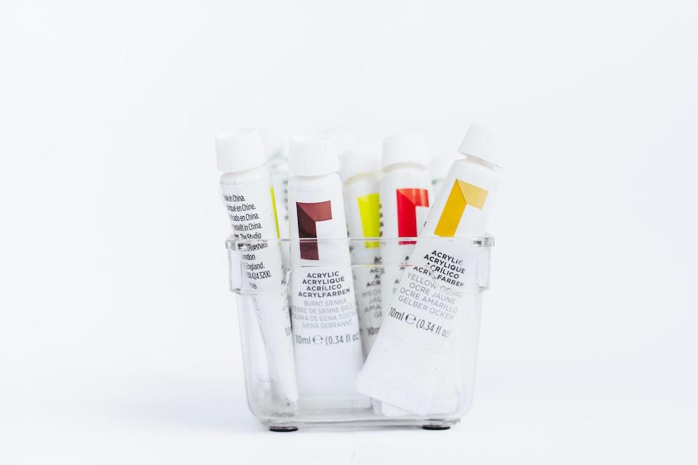 white and yellow plastic tube bottles